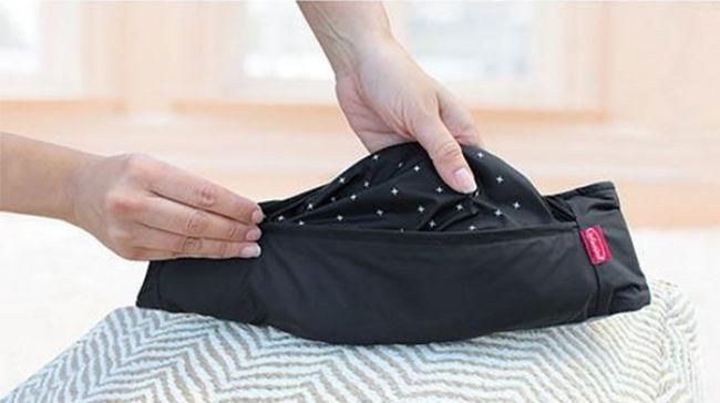 Le Zip travel plié dans sa pochette ceinture
